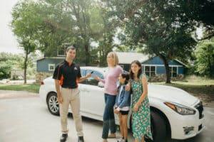 Pop-A-Lock Technician helping family get into white sedan