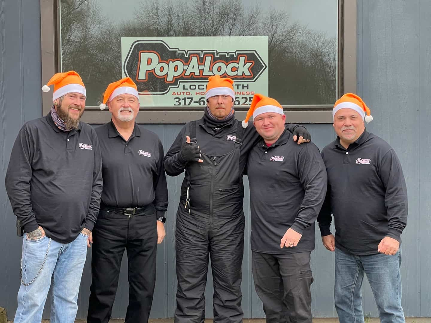 Pop-A-Lock of Indy Team in front of downtown office