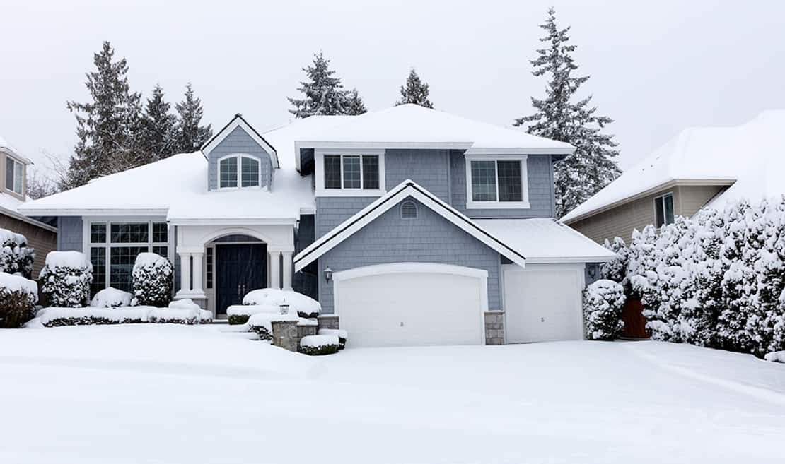 A house blanketed in snow.